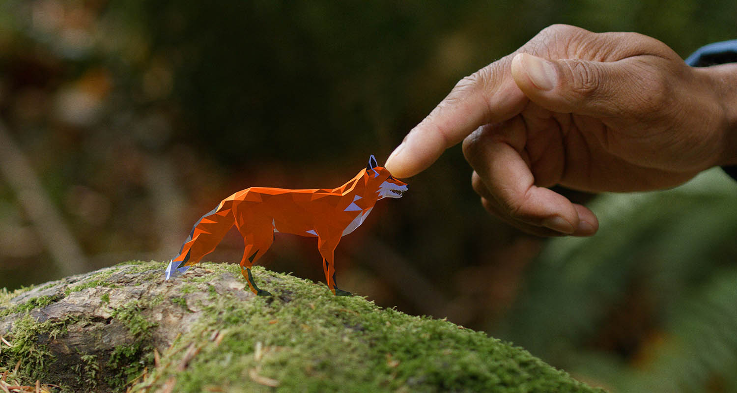 hand touching a virtual fox