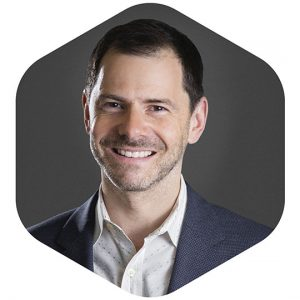 a headshot of haptx's chief revenue officer joe michaels