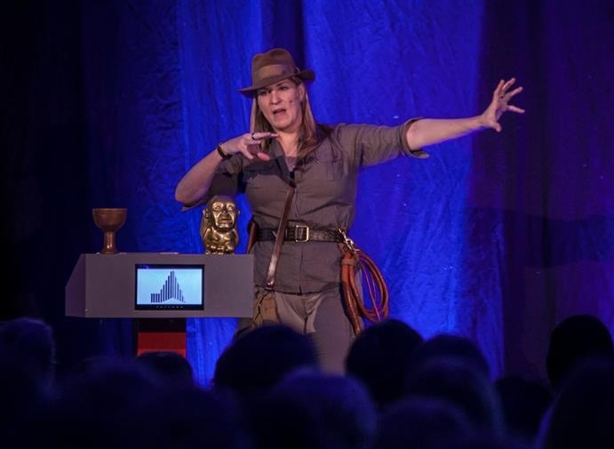 Kate Edwards on stage in an Indiana Jones costume