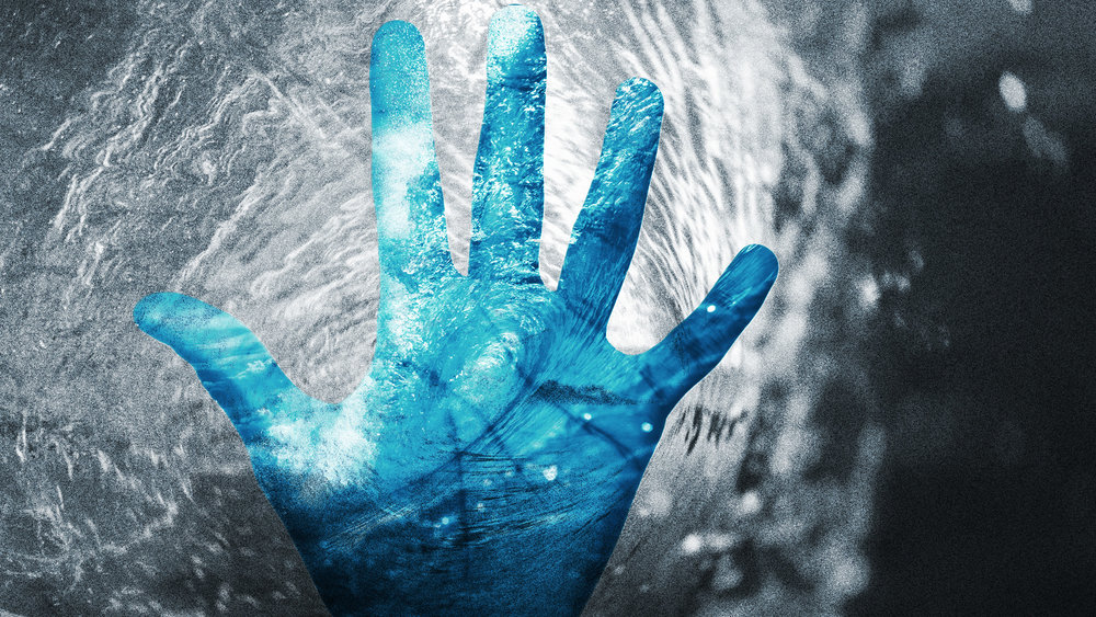 a picture of a blue hand with water